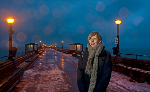 Artist Katie Paterson stands on Deal Pier to watch the lights flicker as lightning strikes are detected from half a worl away. The equipment was designed and installed by our technical team.